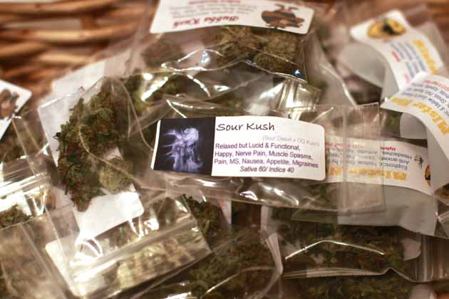 Various marijuana strains are prepared for sale at the Botanacare marijuana store ahead of their grand opening on New Year's day in Northglenn, Colorado